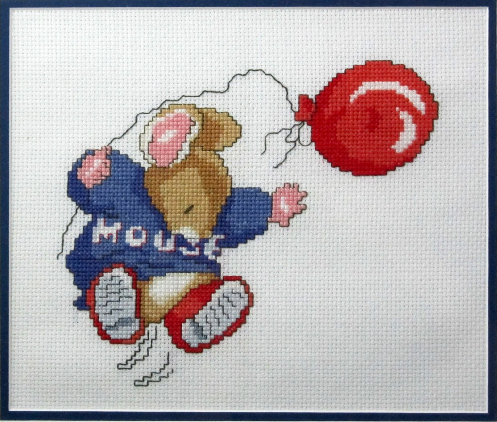 "A completed cross-stitch from the ""Country Companions"" series by DMC."