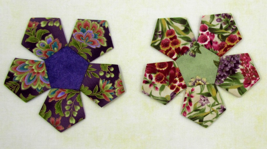Pretty pentagon flowers - these will be appliqued onto the background fabric.