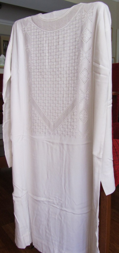 White tunic with embroidered panel.