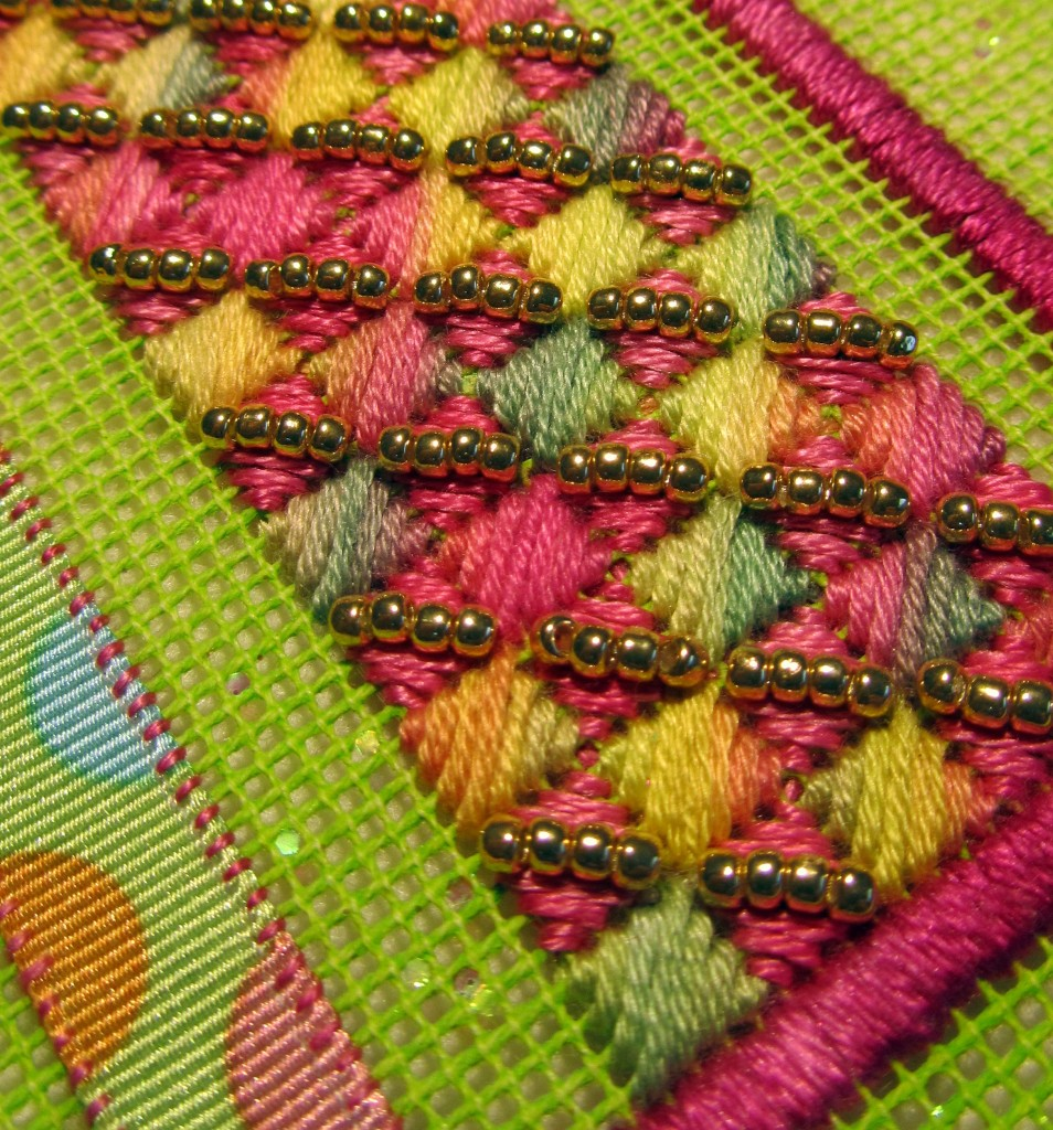 Reverse cushion stitch worked on 18-count canvas and embellished with Toho Japanese Seed Beads 11/0.
