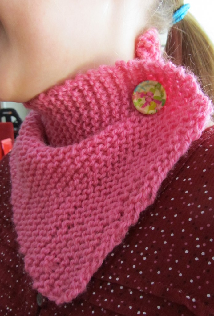 The neck warmer with button worn to the side.