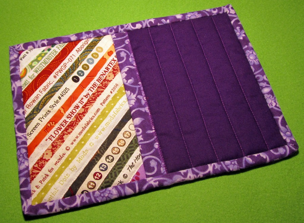 A purple mug rug made using a simple quilt-as-you-go technique.