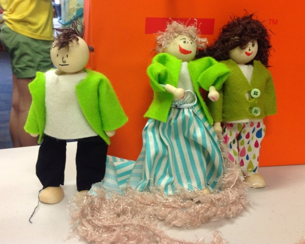 One of my favourite classes from last year - stitching simple outfits for wood and wire dolls. A groovy guy with a mohawk, Rapunzel, and a trendy girl on the town :)