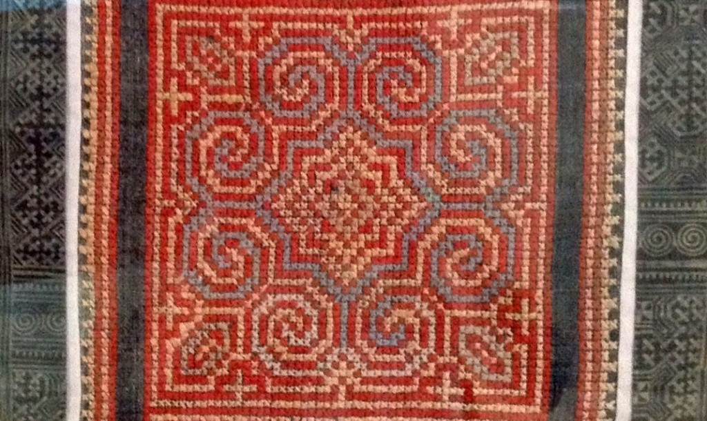 An ethnic cross-stitch hanging on the wall of our apartment (behind glass so please excuse the reflections).
