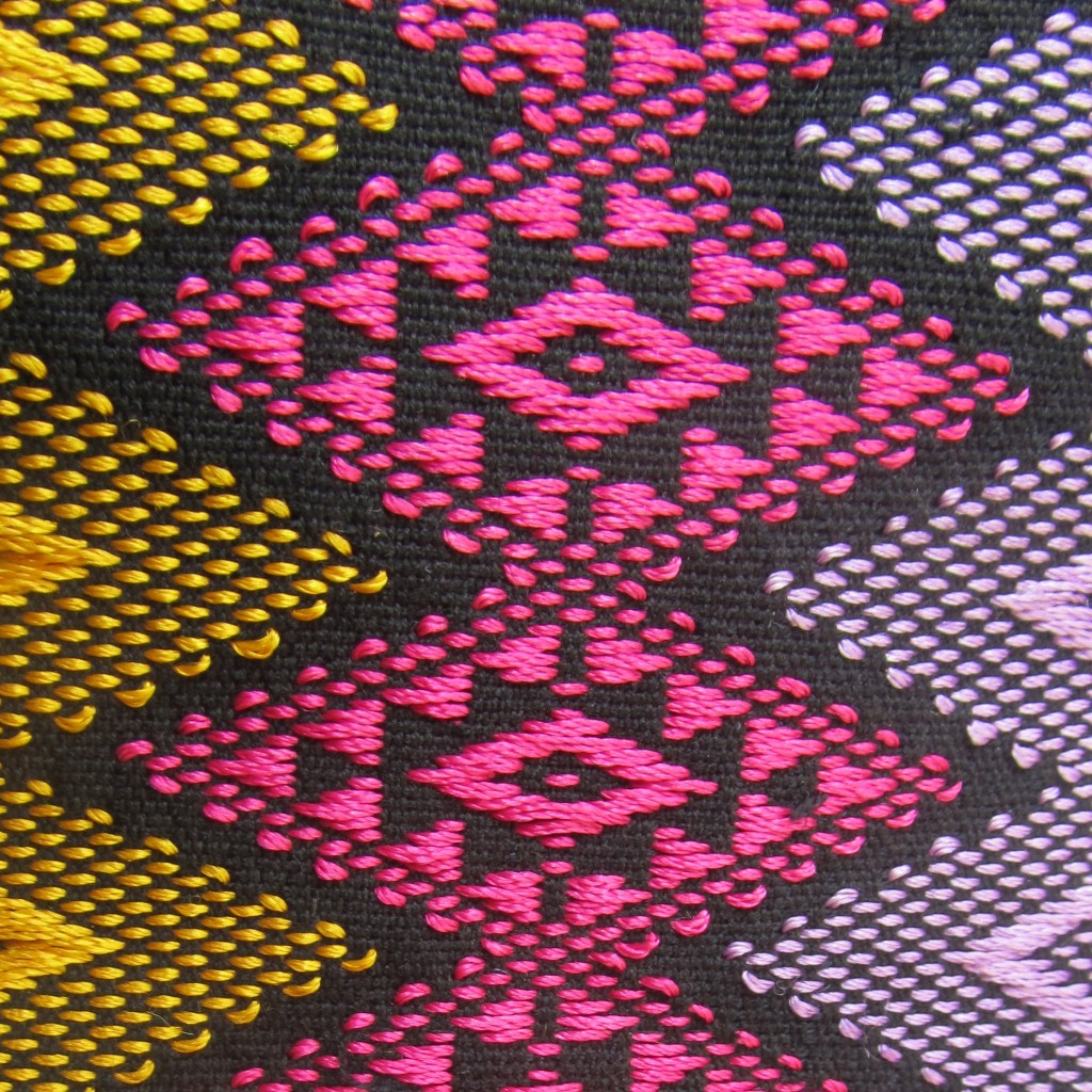 Detail view of the front of the fabric. The long axis of each diamond measures 6cm.
